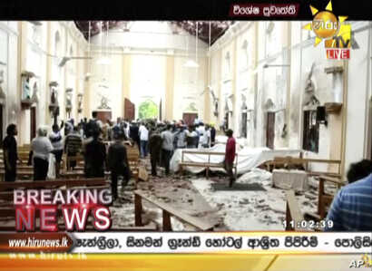 This image made from video provided by Hiru TV shows damage inside St. Anthony's Shrine after a blast in Colombo, April 21, 2019. Near simultaneous blasts rocked three churches and three hotels in Sri Lanka on Easter.