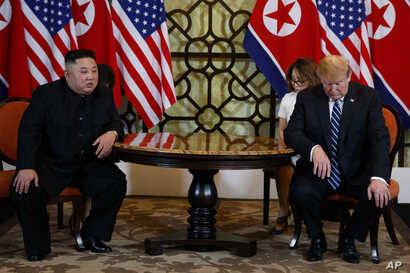 President Donald Trump meets North Korean leader Kim Jong Un in Hanoi., Feb. 28, 2019. (AP Photo/ Evan Vucci)