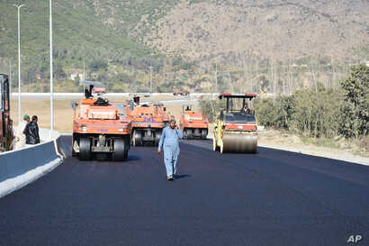 "FILE - Road construction is underway as part of China's ""Belt and Road"" Initiative, in Haripur, Pakistan, Dec. 22, 2017."