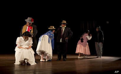 """In this April 30, 2019 photo, members of the """"Kory Warmis,"""" or Women of Gold theater group, perform at the Municipal Theater, in La Paz, Bolivia."""