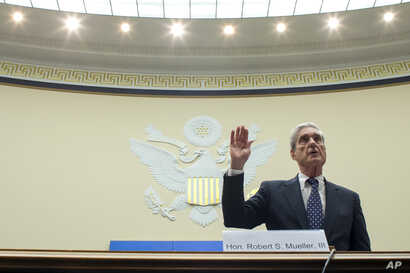 Former special counsel Robert Mueller is sworn in before the House Intelligence Committee to testify on his report on Russian election interference, on Capitol Hill, July 24, 2019, in Washington.