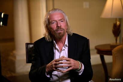 Virgin Galactic founder Richard Branson speaks during an interview while attending the Space Symposium in Colorado Springs, Colorado, April 11, 2019.