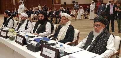 Members of the Taliban political office are seen inside the conference hall at the start of the intra-Afghan dialogue. Sitting far right is Sher Mohammad Abbas Stanekzai, head of the Taliban delegation, in Doha, Qatar, July 7, 2019. (A. Tanzeem/VOA)