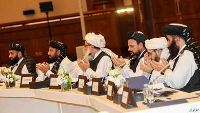 FILE - Members of the Taliban attend the second day of the Intra Afghan Dialogue talks in the Qatari capital, Doha, July 8, 2019.