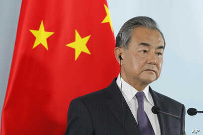 FILE - Chinese Foreign Minister Wang Yi attends a press conference in Beijing, Aug. 21, 2019.
