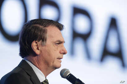 Brazil's President Jair Bolsonaro speaks at the opening of the Brazilian Steel Congress, in Brasilia, Brazil, Aug. 21, 2019.