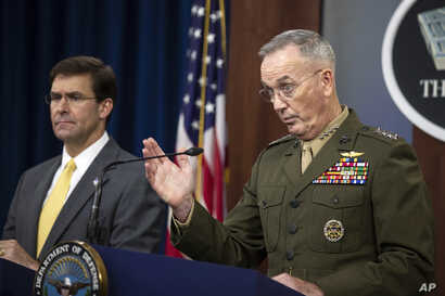 Joint Chiefs Chairman Gen. Joseph Dunford, with Secretary of Defense Mark Esper, speaks to reporters during a briefing at the Pentagon, Aug. 28, 2019.