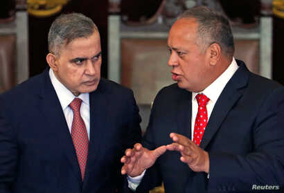 Venezuela's National Constituent Assembly President Diosdado Cabello, right, talks to Chief Prosecutor Tarek William Saab during a ceremony honoring the Supreme Court in Caracas, Jan. 24, 2019.