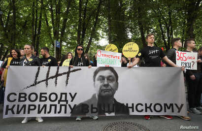 Participants rally in support of Kirill Vyshinsky, director of the Ukrainian office of the Russian state news agency RIA Novosti, who was detained on treason charges in 2018, outside the Ukrainian embassy in Moscow, Russia, May 15, 2019.