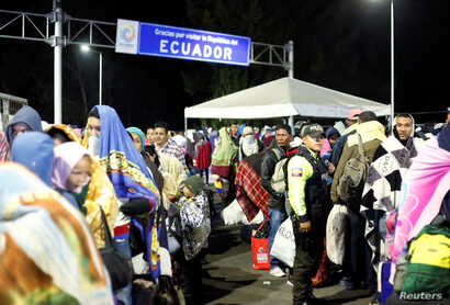 Venezuelans gather to cross into Ecuador from Colombia, as new visa restrictions from the Ecuadorian government took effect, at the Rumichaca border bridge in Tulcan, Ecuador, Aug. 26, 2019.