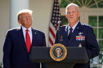 U.S. President Donald Trump listens as U.S. Air Force Gen. John Raymond, commander of SPACECOM, speaks during an an event to officially launch the United States Space Command in the Rose Garden of the White House in Washington, Aug. 29, 2019.