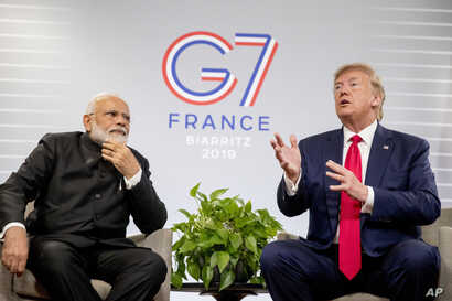 President Donald Trump, accompanied by Indian Prime Minister Narendra Modi, left, speaks during a bilateral meeting at the G-7 summit in Biarritz, France, Aug. 26, 2019.