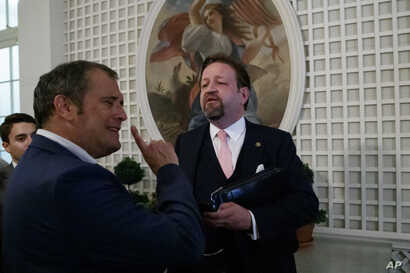 Conservative radio host Sebastian Gorka, right, speaks with Playboy's Brian Karem, after President Donald Trump spoke about the 2020 census in the Rose Garden of the White House, in Washington, July 11, 2019.