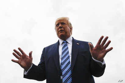 President Donald Trump talks to reporters at Morristown Municipal Airport in Morristown, N.J., Aug. 13, 2019.
