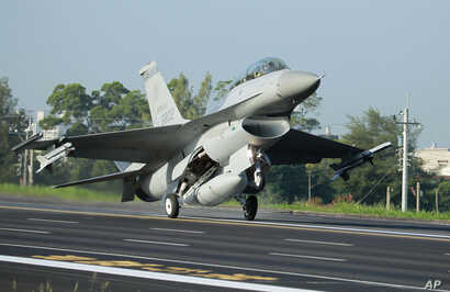 A Taiwan Air Force F-16 fighter jet lands on a closed section of highway during the annual Han Kuang military exercises in Chiayi, central Taiwan, Sept. 16, 2014. U.S. arms sales to Taiwan now reportedly total some $12 billion.