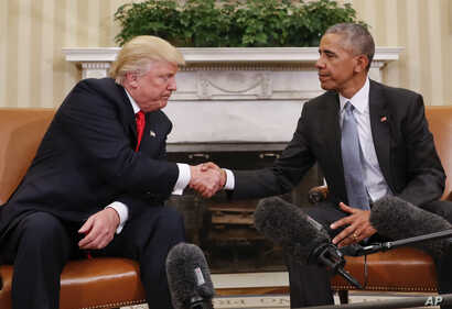 FILE - Then-President Barack Obama and President-elect Donald Trump shake hands following their meeting in the Oval Office of the White House in Washington, Nov. 10, 2016.