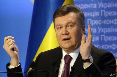 FILE - Then-Ukrainian President Viktor Yanukovych speaks during a press conference in Kyiv, Ukraine, March 1, 2013.