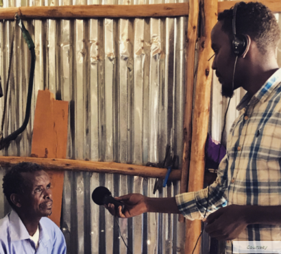Mahad interviews a man at the Bokolmanyo refugee camp, in Bokolmanyo, Ethiopia. (Photo courtesy Dr Vandana Sharma)