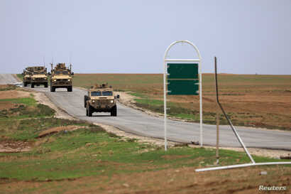 U.S. troops patrol near the Turkish border in Hasakah, Syria, Nov. 4, 2018.