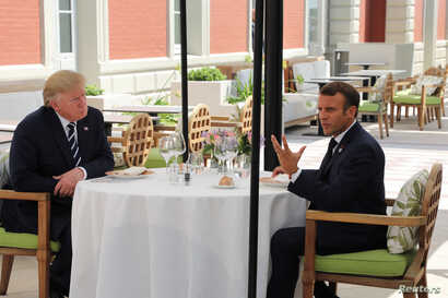 U.S. President Donald Trump (L) sits for lunch with French President Emmanuel Macron, at Hotel du Palais in Biarritz, France, Aug. 24, 2019.