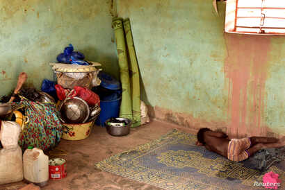 A newly displaced child from Dablo, sleeps inside a house in the city of Kaya, Burkina Faso, May 16, 2019.