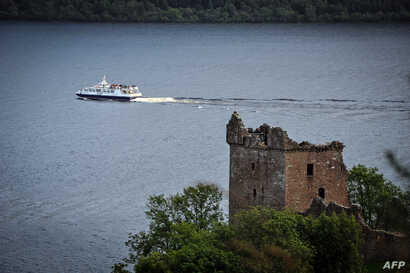 A tourist boat is seen on Loch Ness in Drumnadrochit, Scotland, Sept. 5, 2019.