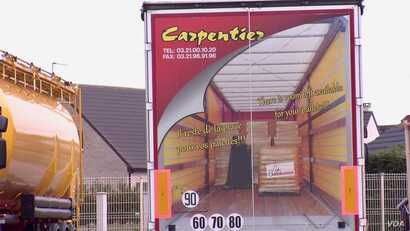 The family-owned Carpentier trucking business counts on Britain for 20 percent of its transport revenues. (L. Bryant/VOA)