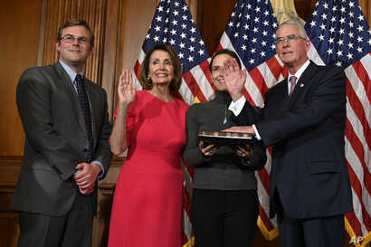 House Speaker Nancy Pelosi of Calif., second from left, poses during a ceremonial swearing-in with Rep. Francis Rooney, R-Fla., right, on Capitol Hill in Washington, Jan. 3, 2019.