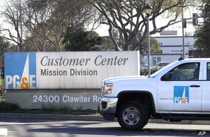 FILE - A Pacific Gas & Electric truck enters their customer center in Hayward, Calif., Jan. 23, 2019.