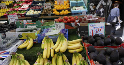 FILE - A fruit stall displays fruit at a market in London, Aug. 7, 2019. Kenya exports cut flowers, fruits and vegetables to Britain.