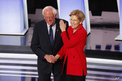 Sen. Bernie Sanders, I-Vt., and Sen. Elizabeth Warren, D-Mass., participate in the first of two Democratic presidential primary