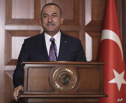 Turkish Foreign Minister Mevlut Cavusoglu speaks to journalists, in Ankara, Turkey, Tuesday, Sept. 10, 2019.