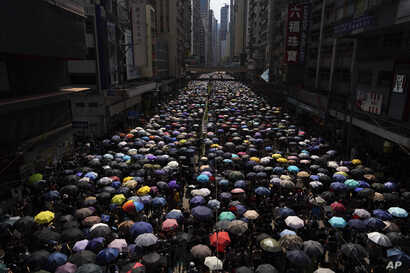 Protesters carrying umbrellas take part in march in Hong Kong, Sept. 15, 2019.