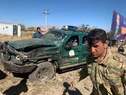 Afghan police inspect the site of a suicide attack, in Parwan province of Afghanistan, Sept. 17, 2019.
