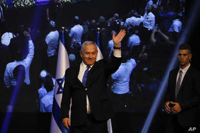 Israeli Prime Minister Benjamin Netanyahu addressees his supporters at party headquarters after elections in Tel Aviv, Israel, Wednesday, Sept. 18, 2019.
