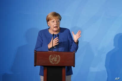 Germany's Chancellor Angela Merkel addresses the Climate Action Summit in the United Nations General Assembly, at U.N. headquarters, Sept. 23, 2019.