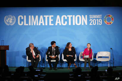 United Nations Secretary-General Antonio Guterres, far left, and young environmental activists look on as Greta Thunberg, of Sweden, far right, addresses the Climate Action Summit in the United Nations General Assembly, Sept. 23, 2019.