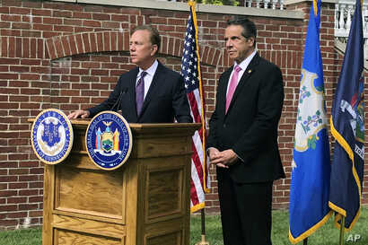 Connecticut Gov. Ned Lamont, left, speaks as New York Gov. Andrew Cuomo listens during a press conference, Sept. 25, 2019, in Hartford, Conn.