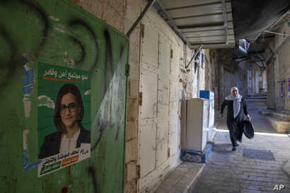 An election campaign poster shows Heba Yazbak, a newly elected Balad party Israeli Arab lawmaker at the market in Nazareth, northern Israel, Sept. 27, 2019.