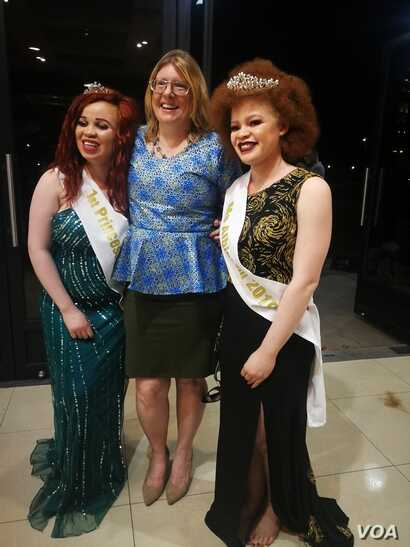 Crown winners of 2019 Ms Malawi Albinism -Chikondi Kadzanja (right) and First Princess Hilda Mcheso poses with lead judge Tamara.