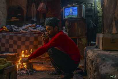 Mostafa, 28,  lives with his cousins in an abandoned bakery and says he believes a new government could help alleviate the crush