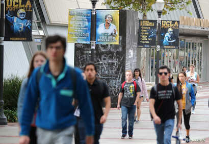 FILE - Students students walk outside the Pauley Pavilion basketball arena at the University of California-Los Angeles, Nov. 15, 2017.