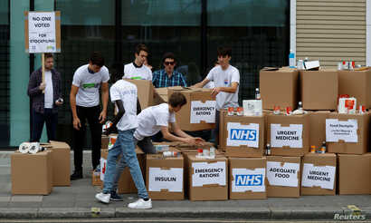 FILE - Protesters demonstrate against the stockpiling of medicines and food in the event of a no-deal Brexit in London, Britain. Aug 22, 2018.