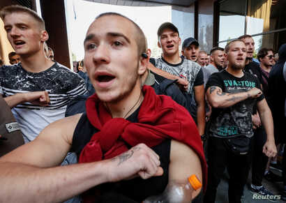 Activists of Ukrainian nationalist groups protest a court decision to release on bail Volodymyr Tsemakh, suspected of involvement in the downing of the Malaysia Airlines Flight MH17 in 2014, in Kyiv, Ukraine, Sept. 5, 2019.