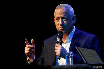 Benny Gantz, the leader of Blue and White party, speaks at an event hosted by the Tel Aviv International Salon ahead of general election, in Tel Aviv, Israel, Sept. 9, 2019.