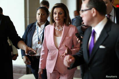 U.S. House Speaker Nancy Pelosi (D-CA) speaks with reporters following her weekly news conference on Capitol Hill in Washington, September 12, 2019.