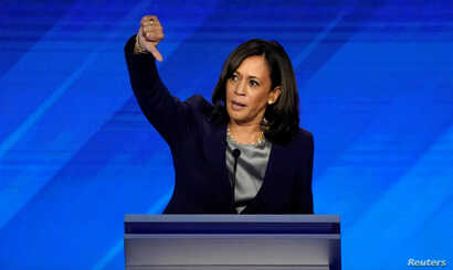 Senator Kamala Harris gives a thumbs down as she speaks during the 2020 Democratic U.S. presidential debate in Houston, Sept. 12, 2019.