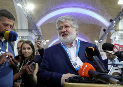 FILE - Ukrainian business tycoon Ihor Kolomoisky speaks with journalists on the sidelines of the Yalta European Strategy annual meeting in Kyiv, Ukraine, Sept. 13, 2019.