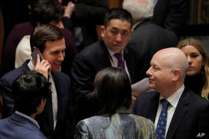 White House senior adviser Jared Kushner, left, speaks with U.S. Ambassador to the United Nations Jason Greenblatt before a meeting of the Security Council in New York, Feb. 20, 2018.