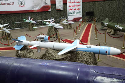 Missiles and drone aircraft are seen on display at an exhibition at an unidentified location in Yemen in this undated handout photo released by the Houthi Media Office on Sept. 17, 2019.